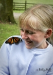 Young girl and Monarch butterfly