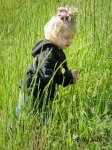 Young girl in tall grass