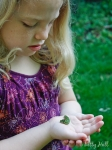 Young girl with Black Swallowtail caterpillar